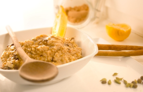 Spiced oatmeal with grated apples, walnuts, raisins and dates. Topped with brown sugar, melted butter, and a sqeeze of lemon.